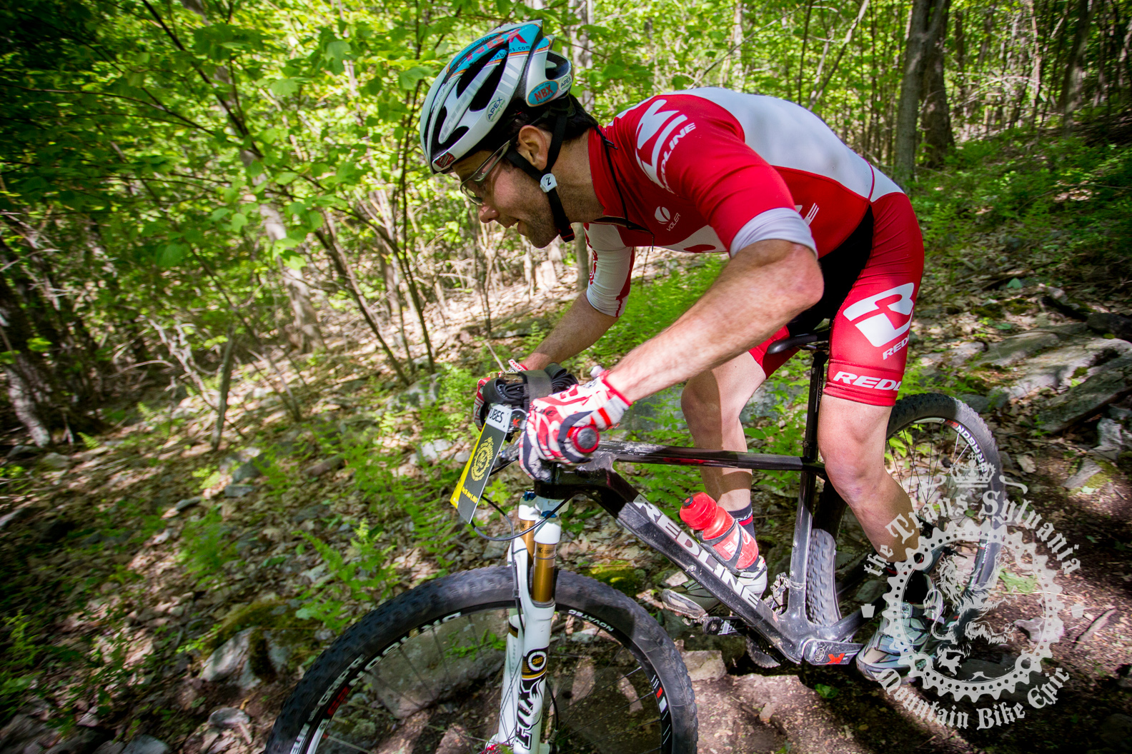 Justin Lindine passing through the rocky downhill section of the Prologue