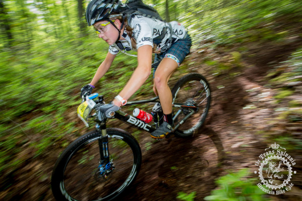 Emily Shields descends the newly reopened trail of the first enduro segment of Stage 6