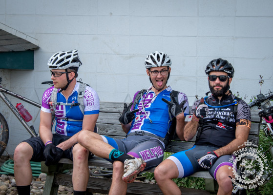 Riders from team Kelpius relax at the start line of stage 3