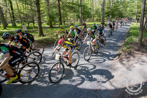 Cheryl Sornson in the peloton leading out on the crushed gravel towards the singletrack