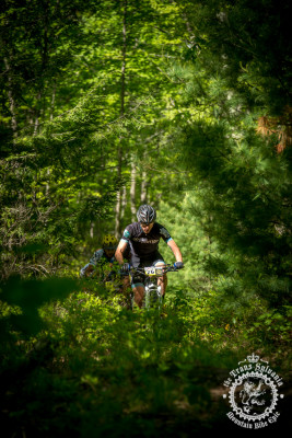Nick Waite rolls through the green singletrack trail in Stage 7