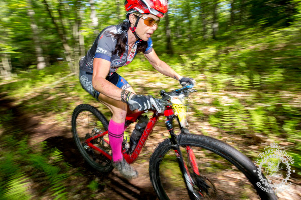 Selene Yeager in a loamy descent as she goes onto win the stage