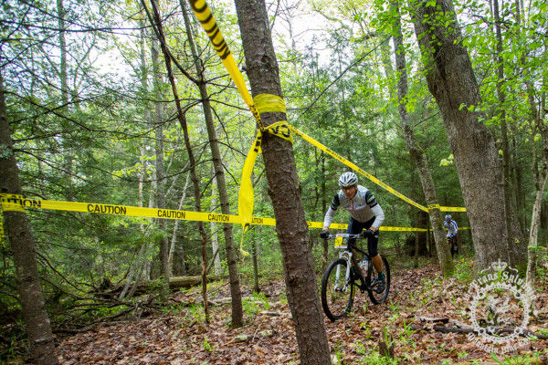 John Merriam rolls through a taped off section of singletrack in Stage 5