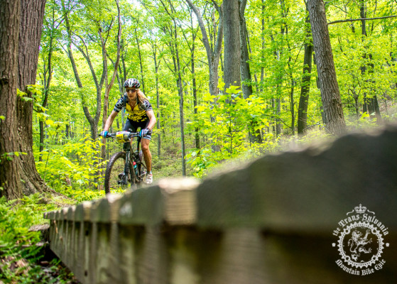 Kristin Walters rides across one of the Three Bri dges near Tussey Mountain