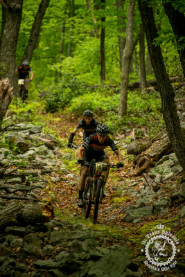 Spencer Paxson hits a rock garden on the enduro segment followed by several riders