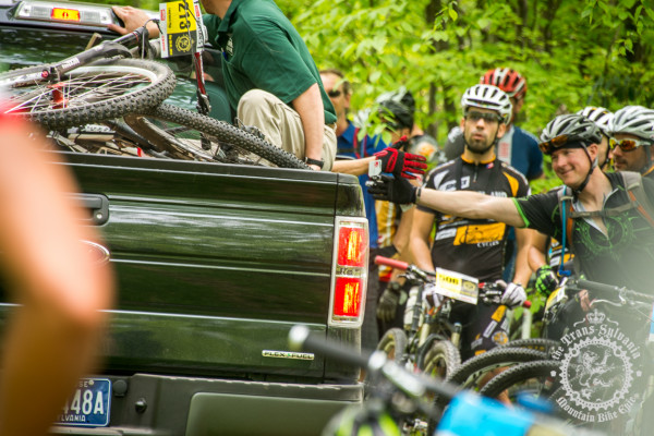 Riders get refreshments during the transfer stages of the Trans-Sylvania Epic enduro