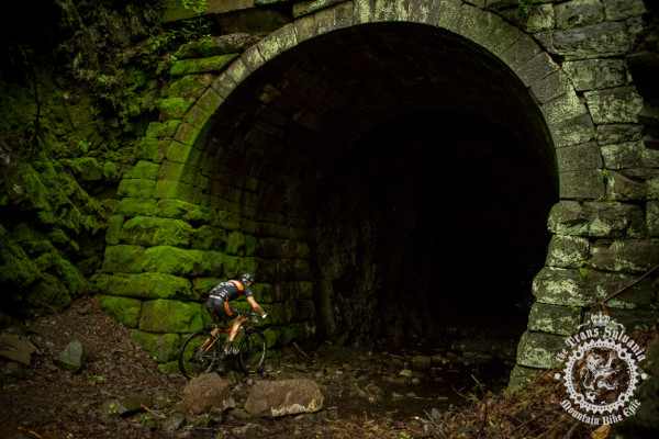 Kris Sneddon enters the Coburn Tunnel in stage 4 of the Trans-Sylvania Epic