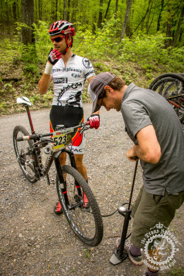 Payson McElveen gets a tire pressure adjustment to combat the flats many riders experienced