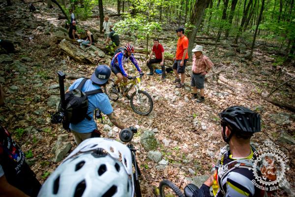 Erik Eiseman pulls through a group of spectators at the bottom of Wildcat Gap