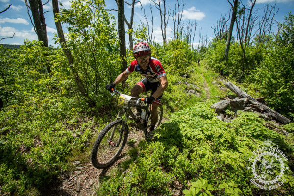 Kurt Gensheimer rides against the beautiful skyl ine of the Tussey Ridge