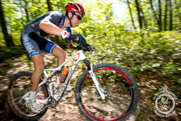 A rider pushes hard through Stage 1's SRAM Enduro segment.