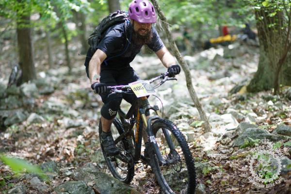 Nick Shepherd smiles as he hits the bottom of the Wildcat Gap Trail rock garden
