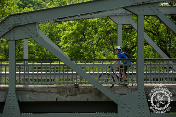 A rider enjoys the bridges of the quaint town of Coburn halfway through stage 4