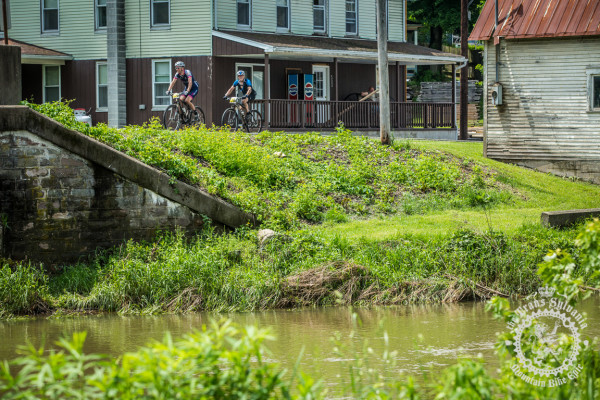 Two riders roll through Coburn, PA during stage 4 of the Trans-Sylvania Epic