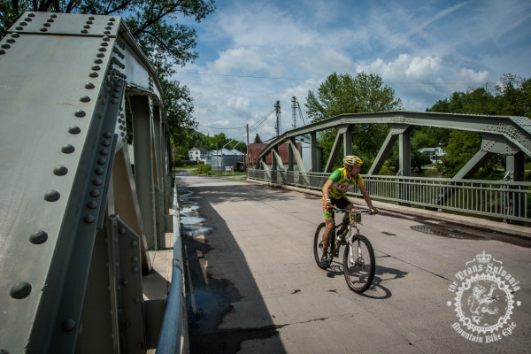Scott Smith hits a bridge through the scenic town of Coburn, PA