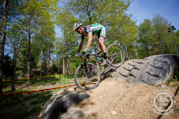 Matt Williams (mtbracing.com) rolls smoothly over a mound of tires.
