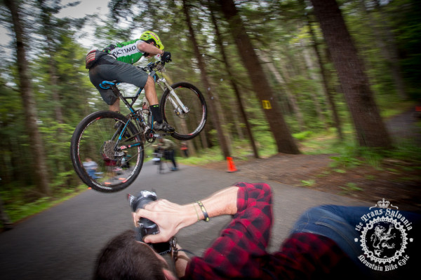 Cody Philips hits the gap over the road for the crowd of photographers