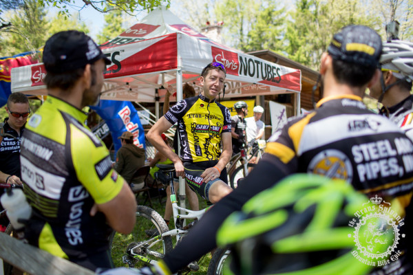 Jeremiah Bishop talks with other racers after finishing the Trans-Sylvania Epic