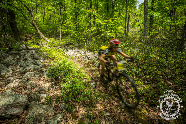 Jessica Nankman descends past a rock a garden on the Enduro Stage