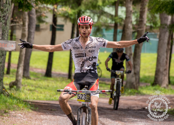 Payson McElveen celebrates his victory as he crosses the finish line of stage 4.