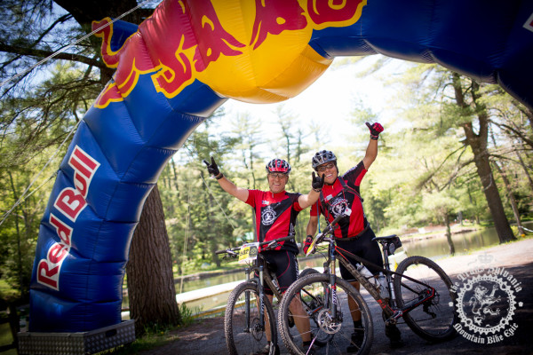 Andres Correa and Juan Ernesto Champsaur, racers from Panama, at the finish line of the Trans-Sylvania Epic