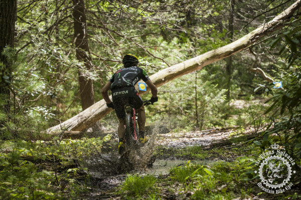 Drew Edsall hits a muddy puddle before a log-under on Stage 2
