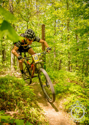 Paxson Spencer railing over the finish of Conklin Trail