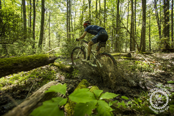 Cole Oberman blasts through a muddy section before hitting a rock garden