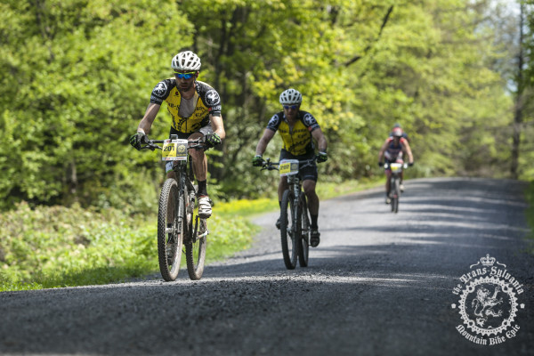 Mike Festa and Craig Lebair hit the gravel between the singletrack sections of the Trans-Sylvania Epic