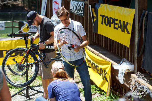 Riders work on their bikes before the start of a stage at the NoTubes Trans-Sylvania Epic, thanks to the support of Topeak.