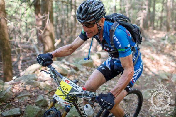 Jay Dodge riding up a rocky climb during the NoTubes Trans-Sylvania Epic.