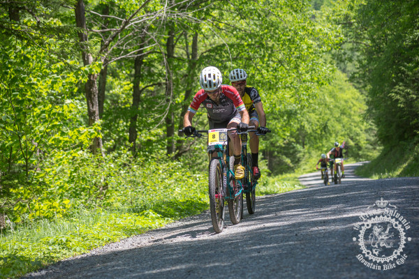 Justin Lindine (Competitive Cyclist) and Payson McElveen (Competitive Cyclist) make a break on a gravel road climb at the NoTubes Trans-Sylvania Epic.