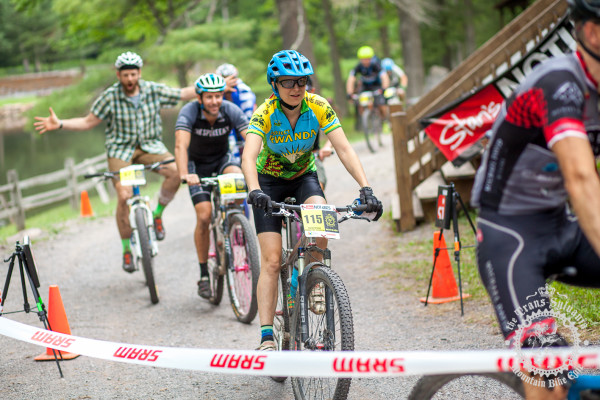 Karen Brooks (NoTubes Trans-Sylvania Epic) crosses the finish with the other singlespeeders at the NoTubes Trans-Sylvania Epic.