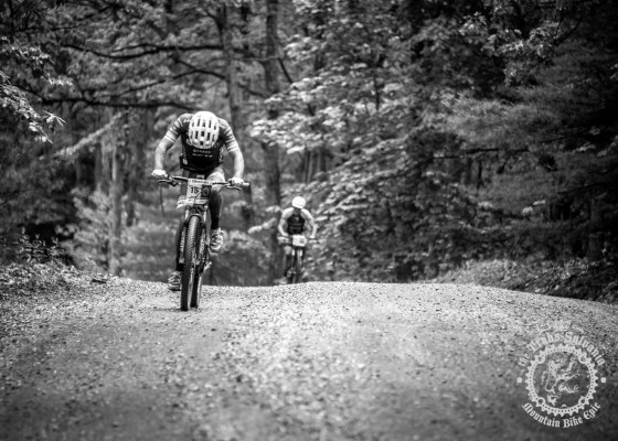 Tristan Uhl (CompetitiveCyclist.com) digging deep on the road at the NoTubes Trans-Sylvania Epic.