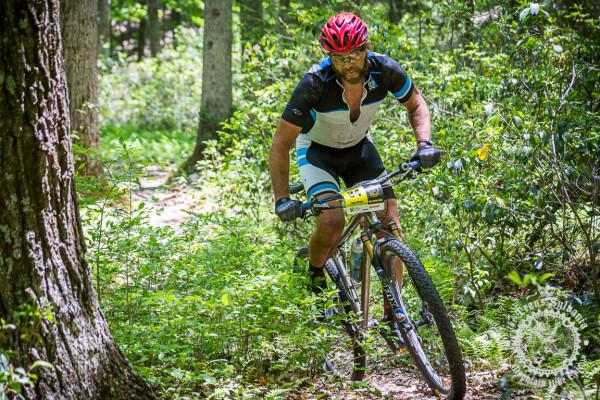 Dejay Birtch rides through winding singletrack in the NoTubes Trans-Sylvania Epic.