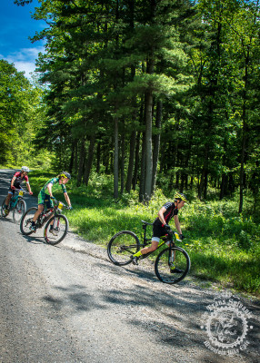 """Peter Glassford (Trek Canada), Drew Dillman (Colt Training Systems), and Tristan Uhl (Competitive Cyclist) demonstrate proper """"moto"""" technique through a loose, gravel corner at the NoTubes Trans-Sylvania Epic."""