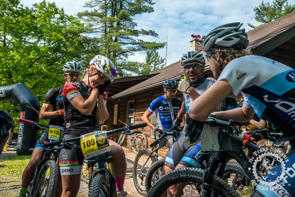 Riders chat at the start before the race for stage 7 of the NoTubes Trans-Sylvania Epic.