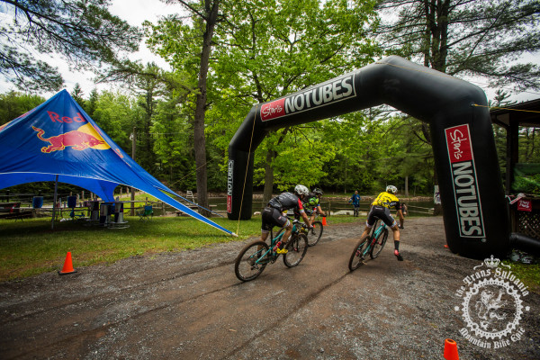 Dan Timmerman (Riverside Racing), Payson McElveen (Competitive Cyclist), and Justin Lindine (Competitive Cyclist) sprint for the finish of stage 4 at the NoTubes Trans-Sylvania Epic.