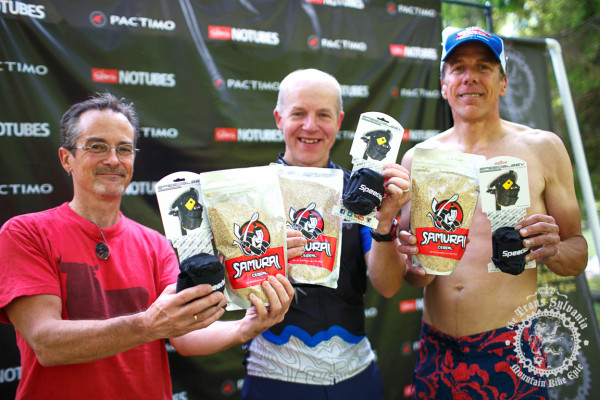 The Men's 50+ podium shows off their prizes from SpeedSleev and Samurai Cereal after stage 2 of the NoTubes Trans-Sylvania Epic.