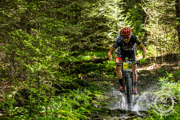 Cody Kaiser (Colt Training Systems) splashes through a wet section of trail at the NoTubes Trans-Sylvania Epic.