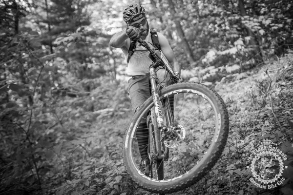 Dejay Birtch (Stan's NoTubes/Rudi Cycling Art/Osprey) pulls a wheelie on the trail at the NoTubes Trans-Sylvania Epic.