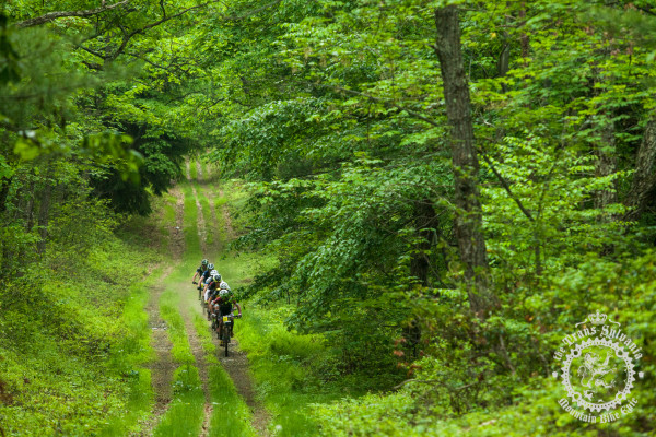 A group of riders speeds through a jeep-track descent at the NoTubes Trans-Sylvania Epic.