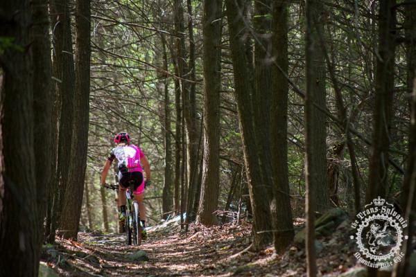 A Stan's NoTubes Elite Women's Team rider riding through a hidden rock garden at the NoTubes Trans-Sylvania Epic.