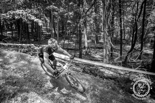 Gary Hoehne (Deathrow/Vassage Cycles) enjoys a fast, bermed-out descent at the NoTubes Trans-Sylvania Epic.