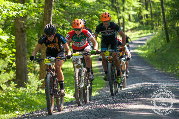 Riders make their way through sections of gravel road linking singletrack on stage 6 of the NoTubes Trans-Sylvania Epic.