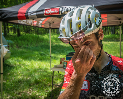 Justin Lindine (Competitive Cyclist) clears mud from his eyes at the finish of stage 6 of the NoTubes Trans-Sylvania Epic.